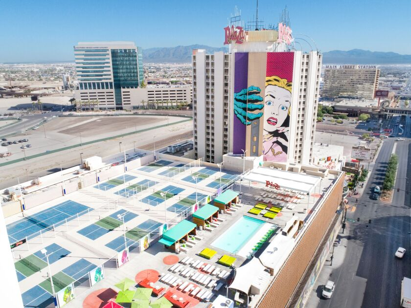 """The pool deck playground at The Plaza Hotel & Casino in downtown Las Vegas offers an arty view of the massive mural """"Behind Closed Doors,"""" by D*Face, one of three murals on the tower's exterior. The other two are by hip artists Shepard Fairey and Faile."""