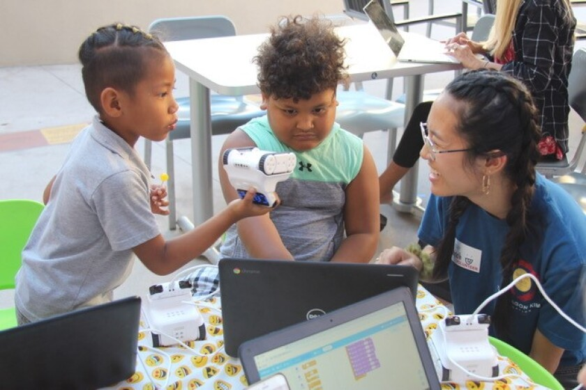 Carlsbad High School student Hannah Hong teaches young cancer patients coding at Ronald McDonald House in San Diego.