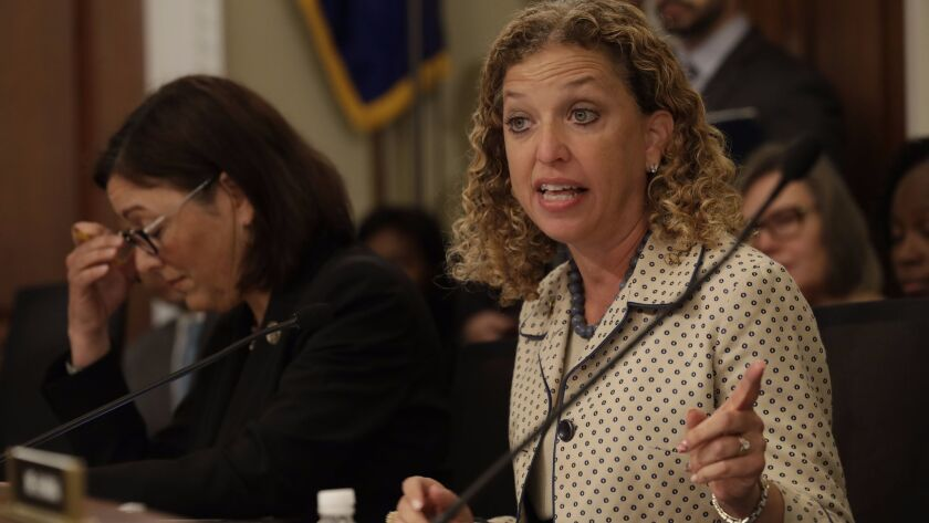 Rep. Debbie Wasserman Shultz (D-Fla.) has fired an information technology staffer who was arrested on a federal bank fraud charge.