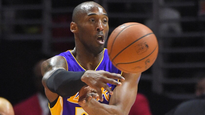 Lakers guard Kobe Bryant passes during a loss to the Clippers at Staples Center on Jan. 7.