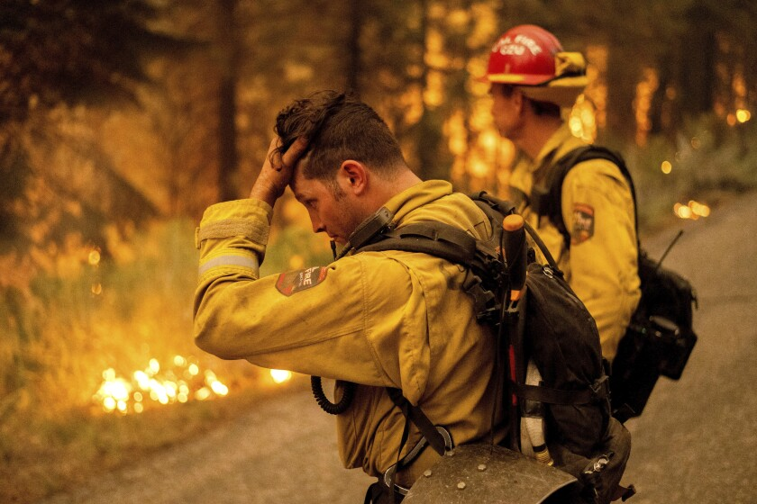 Firefighter Jesse Forbes rubs his head