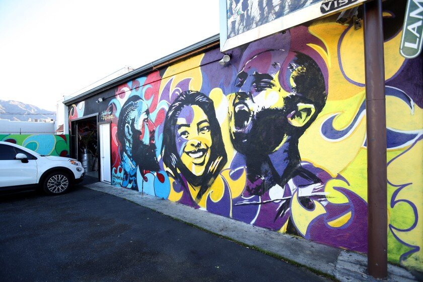 Local artists Arthur Akopyan and Haibert Sarkissian created a mural on the SplatterHaus building, commemorating the late Kobe and Gigi Bryant as well as rapper Nipsey Hussle, in Burbank.