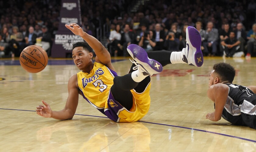 Lakers forward Anthony Brown (3) and Spurs forward Kyle Anderson scramble for a loose ball during the first half on Jan. 22.