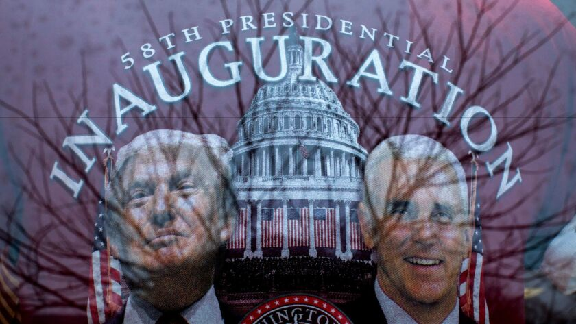 T-shirts and other Donald Trump paraphernalia are displayed in the window of White House Gifts in Washington, D.C. on Tuesday. Trump will be sworn in as the 45th U.S. president Friday.