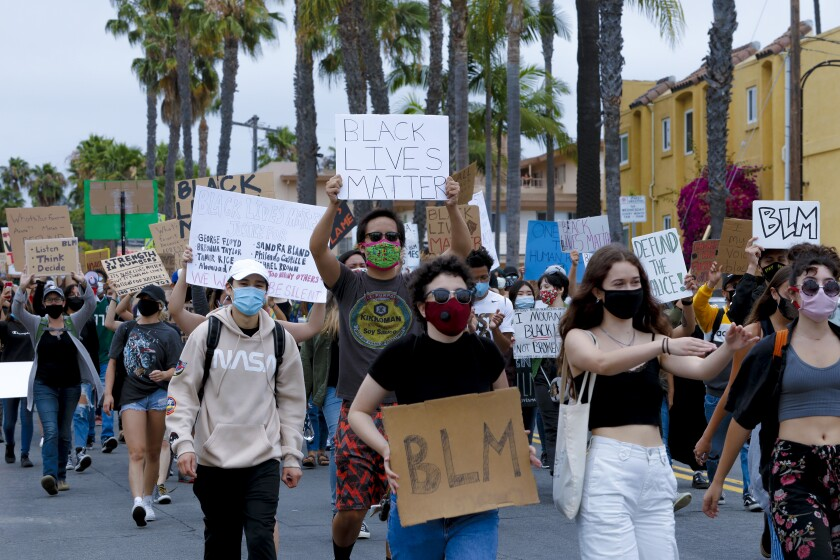 An estimated 400 protestors marched down Garnet Avenue in Pacific Beach on Wednesday showing support for Black Lives Matter.