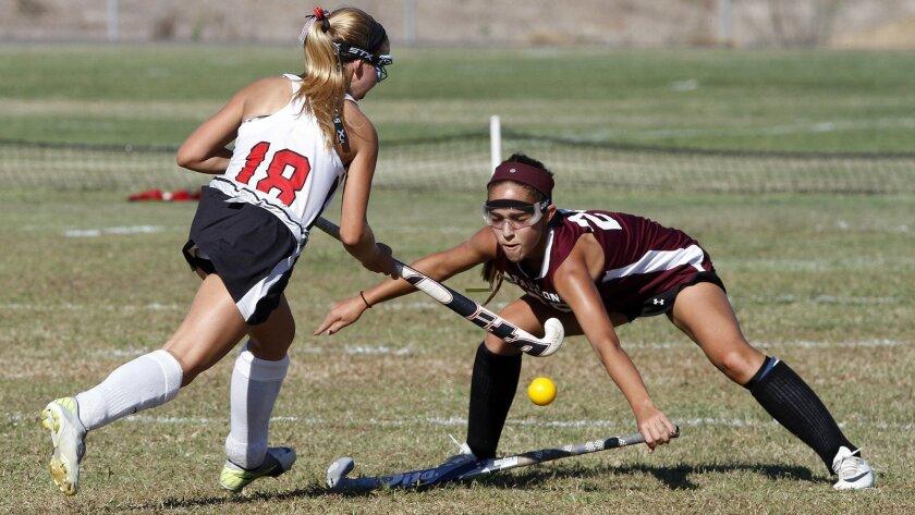 Canyon Crest's Haley Schroeder (left) drives past the defense of Torrey Pines' Farah Farjood.