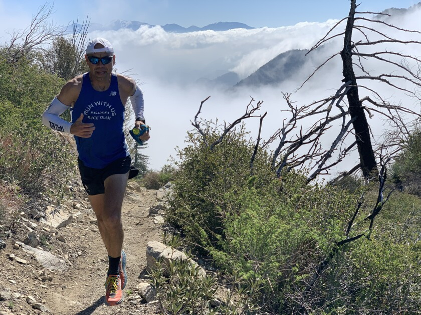 Jerry Garcia runs at the San Gabriel Peak in the Angeles National Forest. In the background is Mt. Wilson.
