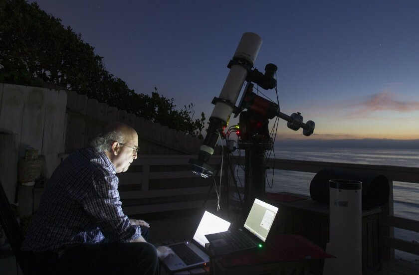 Dr. Paul Aisen engaging in his hobby of astrophotography at his seaside home in Solana Beach. / photo by Sean M. Haffey