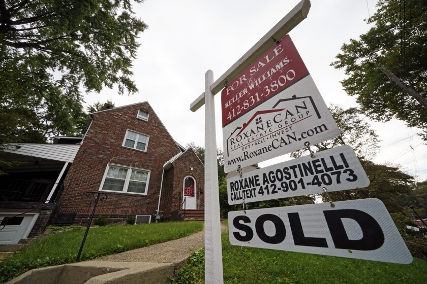 This is a home sold in Mount Lebanon, Pa., on Tuesday, Sept. 21, 2021. Average long-term mortgage rates rose slightly this week continuing a months-long trend of little movement. They remained under 3%. Mortgage buyer Freddie Mac reports that the average rate for a 30-year mortgage edged up to 2.88% from 2.86% last week. (AP Photo/Gene J. Puskar)