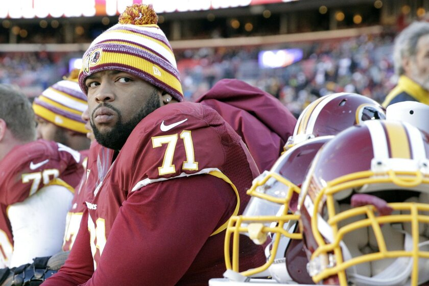 Washington Redskins tackle Trent Williams watches a 2014 game.
