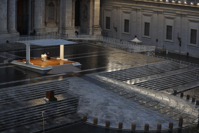 Pope Francis delivers a prayer March 27 from the empty St. Peter's Square at the Vatican.