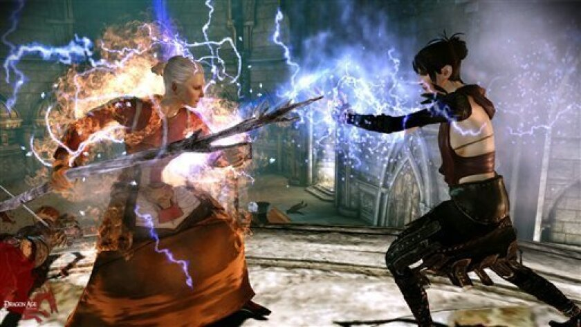 "FILE - In this file video game image released by Electronic Arts, two mages battle in a scene from ""Dragon Age: Origins."" (AP Photo/Electronic Arts, File)"