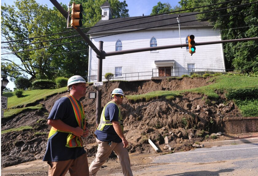 The hill in front of the A.M.E. Baptist Church is seen washed away in the overnight flash flood that hit Main Street in Ellicott City, Md., Sunday, July 31, 2016. Historic, low-lying Ellicott City, Maryland, was ravaged by floodwaters Saturday night, killing a few people and causing devastating dam