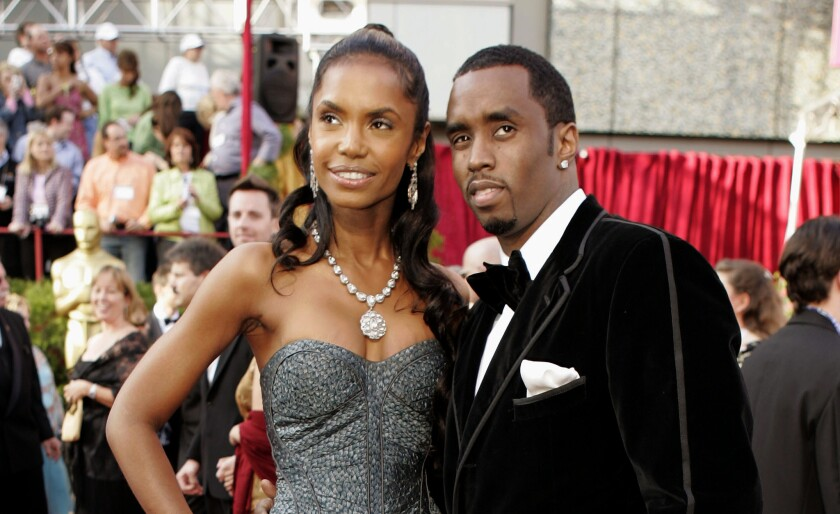 """Sean """"P. Diddy"""" Combs arrives with date, Kim Porter, for the 77th Academy Awards in Los Angeles Feb. 27, 2005."""