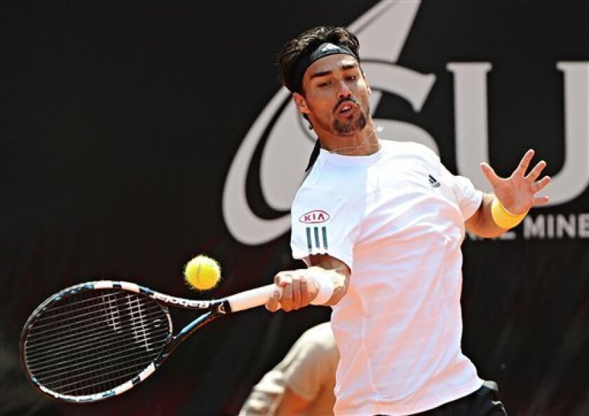 Italian Fabio Fognini returns a ball to Roberto Bautista Agut of Spain, during the semifinal match of the Mercedes Cup ATP Tennis tounament in Stuttgart, Germany, Saturday July 13, 2013. Fifth-seeded Fabio Fognini of Italy eased past Roberto Bautista Agut of Spain 6-1, 6-3 on Saturday to reach the final of the ATP Mercedes Cup. Fognini is one win away from the first title of his career. He advanced to the third final of his career and the first this season. He is the second Italian to reach the