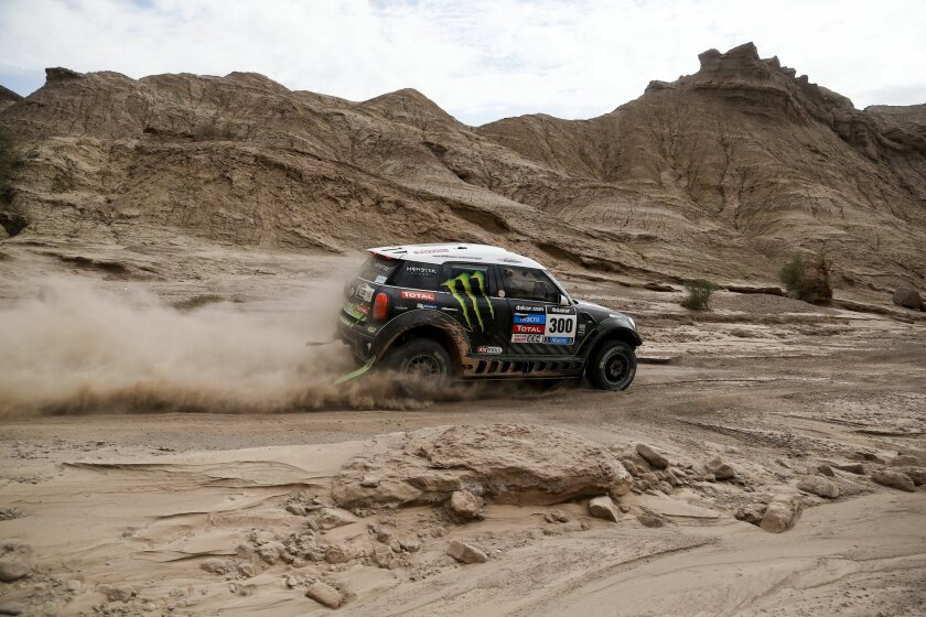Mini driver Stephane Peterhansel and co-pilot Jean Paul Cottret, both from France, compete in the fourth stage of the Dakar Rally between the cities of San Juan and Chilecito in Argentina, Wednesday, Jan. 8, 2014. (AP Photo/Victor R. Caivano)