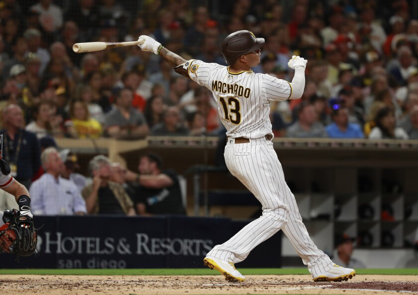 Padres' Manny Machado hits a home run in the third inning against the San Francisco Giants.
