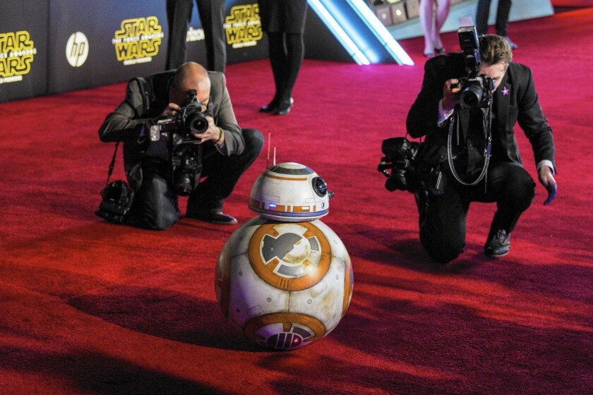 """BB-8 is surrounded by photographers at the red-carpet Hollywood premiere of """"Star Wars: The Force Awakens."""""""