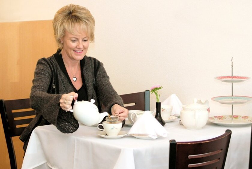 Mary's English Kitchen co-owner Alison Brown demonstrates proper English tea service. The restaurant features dishes prepared from her mother's recipe book.