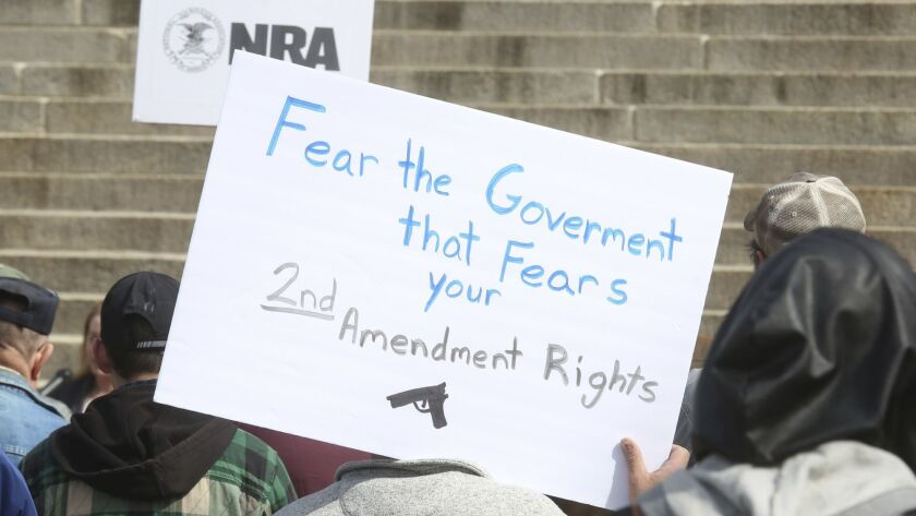 People gather in April for a 2nd Amendment rally on the steps of the Kansas Statehouse.