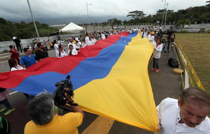 Several dozen Venezuelan physicians participate in a demonstration on Feb. 10, 2019, at the Tienditas border bridge to Colombia in favor of allowing humanitarian aid to enter the country. EFE-EPA/ Mauricio Dueñas Castañeda