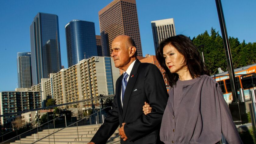 Former Los Angeles County Sheriff Lee Baca, left, with his wife, Carol Chiang, arrive at federal court earlier this month. Baca is charged with obstruction of justice, conspiracy and making false statements to federal investigators.
