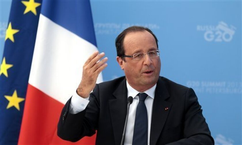 French President Francois Hollande speaks during a media conference after a G-20 summit in St. Petersburg, Russia on Friday, Sept. 6, 2013. World leaders discussed Syria's civil war at the summit but looked no closer to agreeing on international military intervention to stop it. (AP Photo/Ivan Sekretarev)