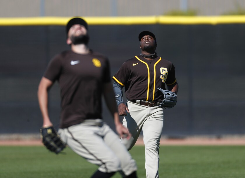 Jorge Oña tracks a ball in right field during a Padres spring training drill.