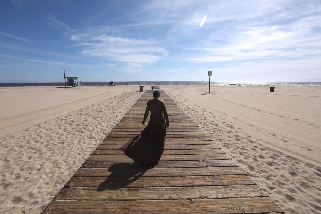 Majid Bradshaw, 33, makes his way down a walkway on a hot afternoon in Santa Monica.