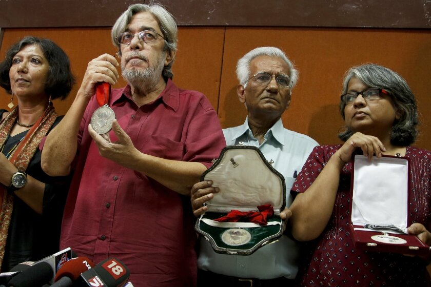From left, Madhushree Dutta, Saeed Mirza, Kundan Shah and Irene Malik Dhar who are among Indian film industry figures returning National Film Awards pose before the media in Mumbai, India, Thursday, Nov. 5, 2015. Booker Prize-winning novelist Arundhati Roy and two dozen Bollywood award winners adde