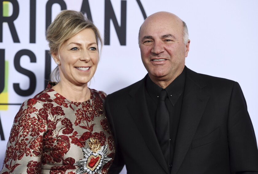 """FILE - In this Nov. 19, 2017, file photo, Linda O'Leary and Kevin O'Leary arrive at the American Music Awards at the Microsoft Theater in Los Angeles. Linda O'Leary, the wife of """"Shark Tank"""" star Kevin O'Leary, has been charged with careless operation of a vessel in a fatal boat crash in Canada, authorities said Tuesday, Sept. 24, 2019. (Photo by Jordan Strauss/Invision/AP, File)"""