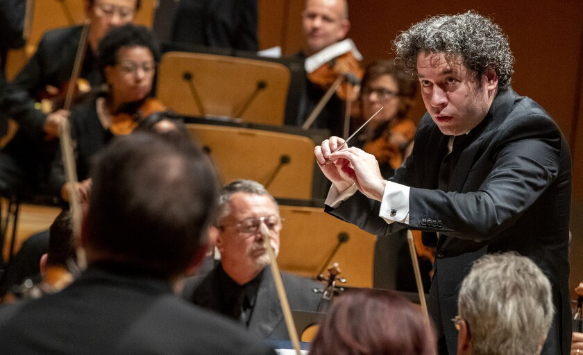 "Gustavo Dudamel conducts the L.A. Phil during performance of  Andrew Norman's centennial commission, ""Sustain,"" at Walt Disney Concert Hall in Los Angeles on Nov. 2."