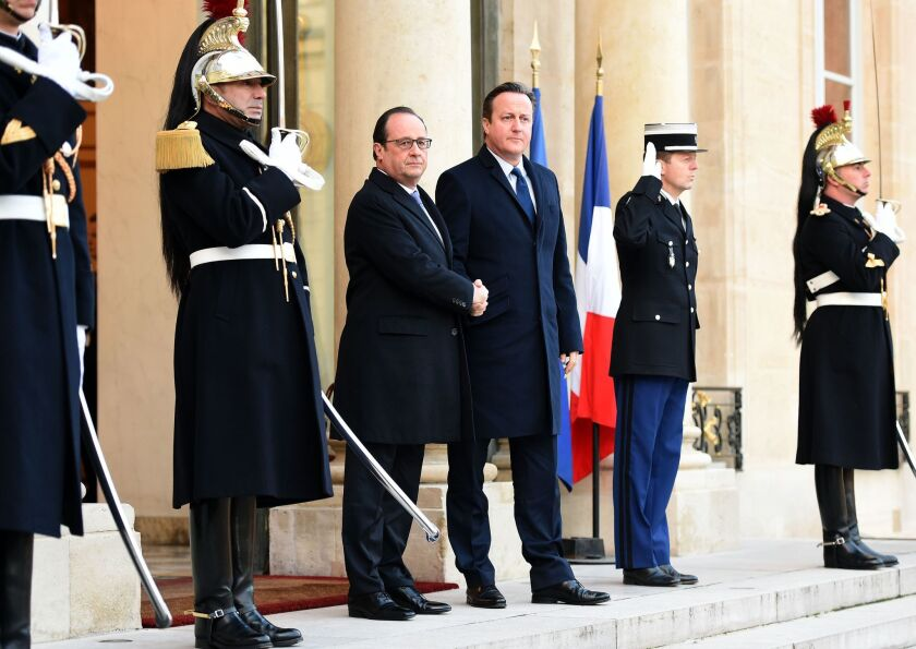 French President Francois Hollande shakes hands with British Prime Minister David Cameron at the Elysee Palace in Paris on Nov. 23.