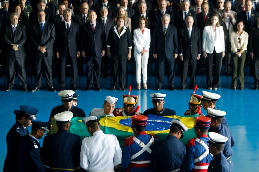 Brazilian President Dilma Rousseff, sixth from the right, stands next to Maria Teresa Goulart, widow of former President João Goulart, and other dignitaries at a reception during the arrival of Goulart's coffin at the air base in Brasilia.