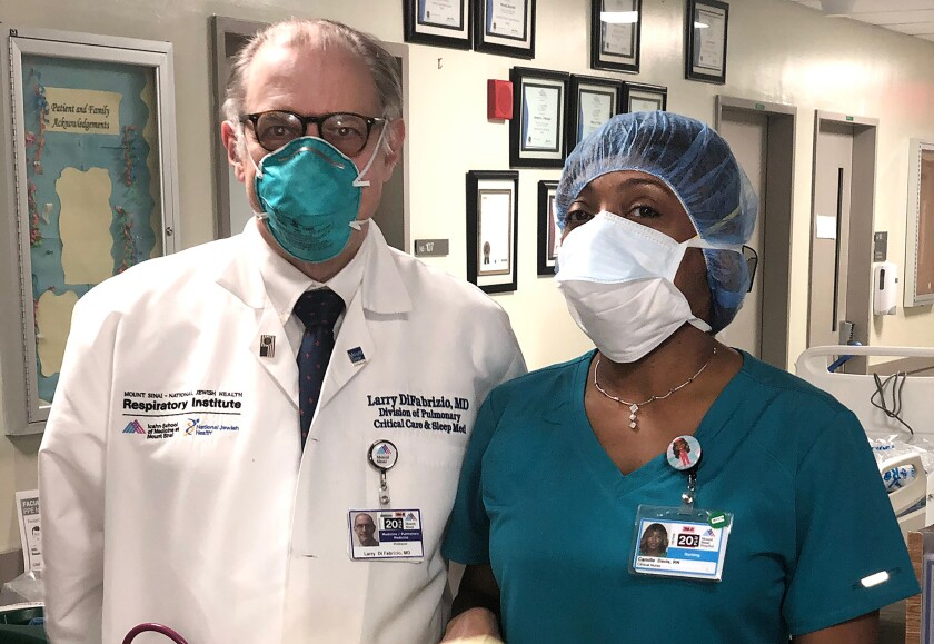 Dr. Larry Di Fabrizio and nurse Camille Davis of Mt. Sinai in their personal protection equipment (PPE).