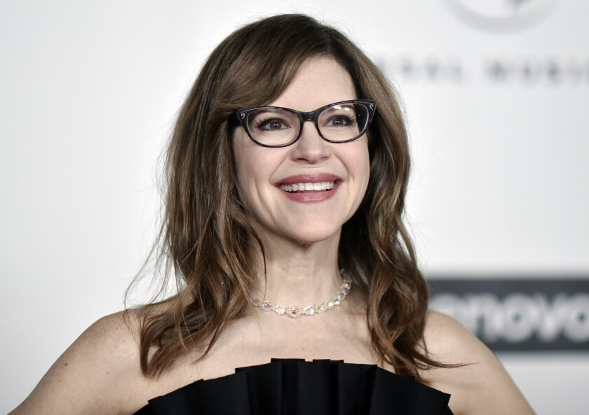 """FILE - Grammy Award-winner Lisa Loeb attends the Universal Music Group 2020 Grammy after party in Los Angeles on Jan. 26, 2020. Loeb was inspired to capture the weirdness, wonder and horror of 2020 during a Brown University online reunion. She tapped dozens of her fellow alumni to create """"Together Apart,"""" a collection of 10 mini-musicals that capture a year online. (Photo by Richard Shotwell/Invision/AP, File"""