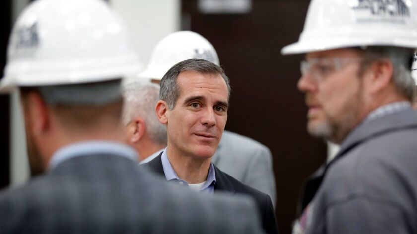 Mayor Eric Garcetti visits with staff during a tour of a carpenters training facility in Altoona, Iowa, on April 13.