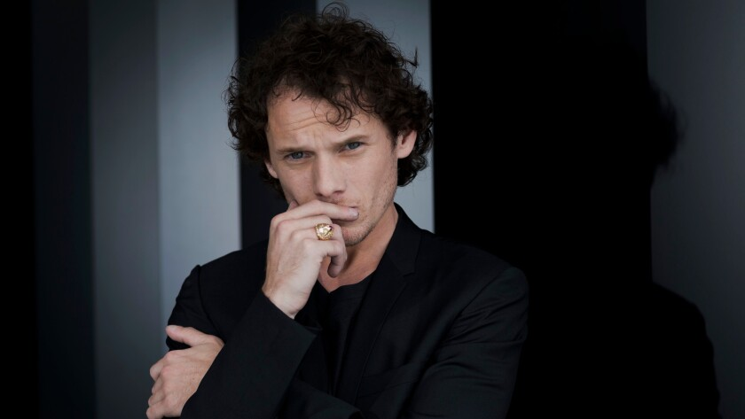 Actor Anton Yelchin poses for portraits during the 71st edition of the Venice Film Festival in Venice, Italy.