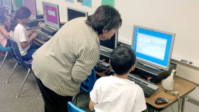 Vicki Brown instructs a student at a computer at La Canada Elementary School. Writer Jeff Olson say