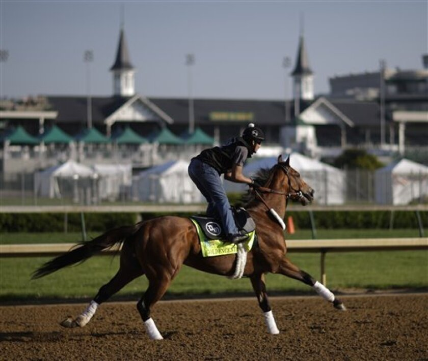 Exercise rider Jonny Garcia rides Kentucky Derby hopeful Goldencents for a workout at Churchill Downs Tuesday, April 30, 2013, in Louisville, Ky. (AP Photo/David Goldman)