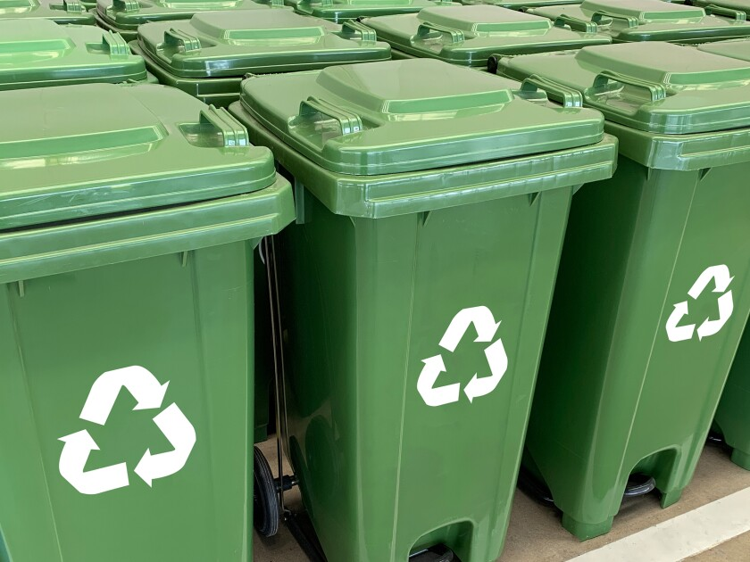 Green recycling bins for landscaping and food waste.