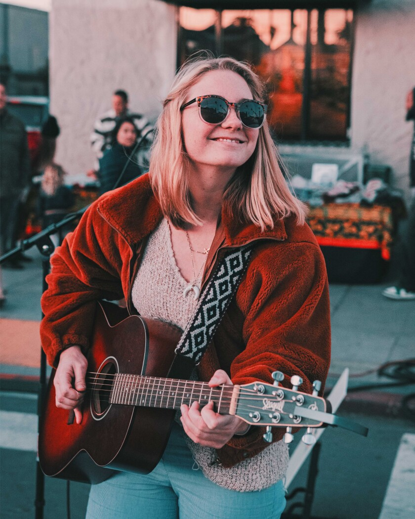 Ocean Beach musician Paige Koehler performs at an outdoor gig.