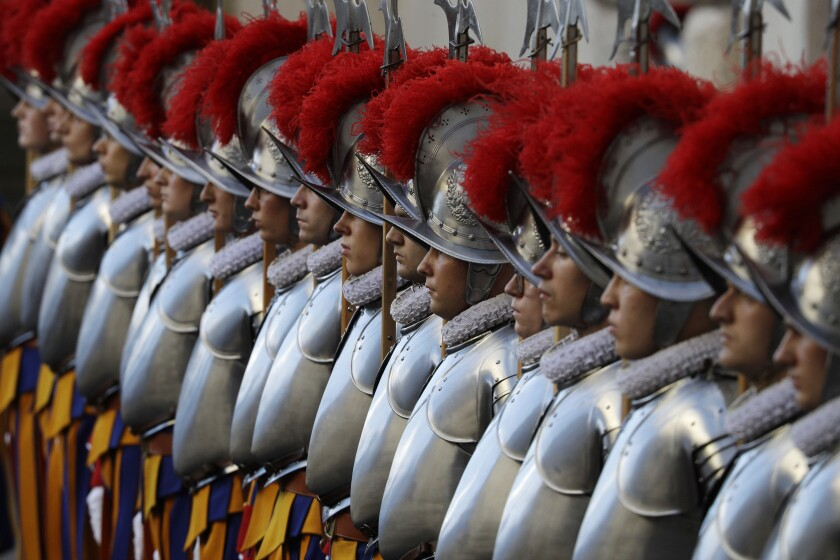 Vatican Swiss Guards stand at attention at their swearing-in ceremony.