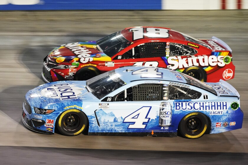 Kevin Harvick, front, passes Kyle Busch during Saturday's NASCAR Cup race at Bristol Motor Speedway.