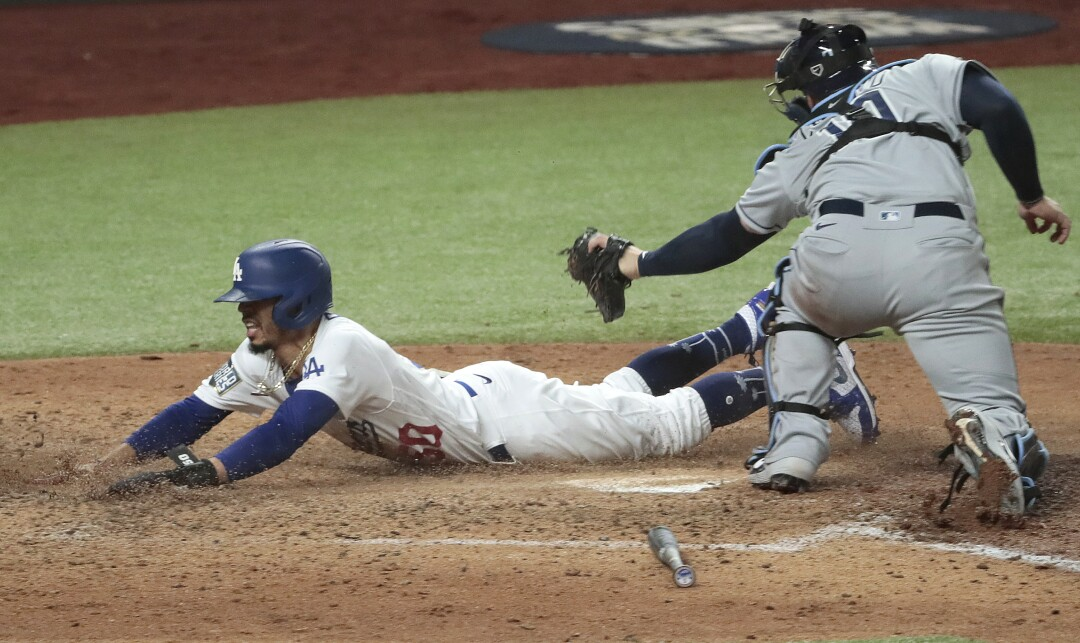Dodgers right fielder Mookie Betts scores ahead of the tag of Tampa Bay Rays catcher Mike Zunino.