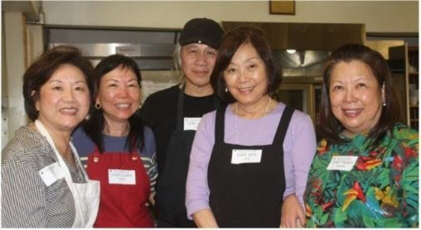 Theresa Song, Clara Wen, head chef Jimmy Chen, Rita Hsia and Peggy Cheong will help prepare dishes for UCSD International Center's Chinese New Year banquet.