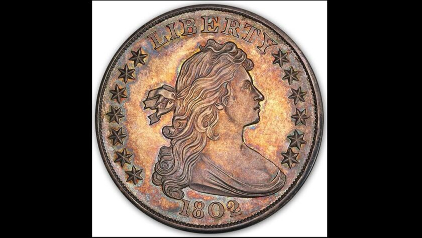 Tangible Investments, a Laguna Beach coin dealer, recently sold a rare silver dollar for more than $