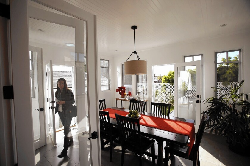 Prospective home buyer Jennifer Centazzo walks through the dining area of a Westchester home during an open house in December.