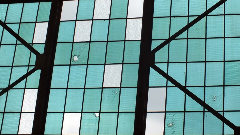 Nearly 75 years after the Japanese attack on Pearl Harbor, bullet holes remain in the windows of a hangar at the Pacific Aviation Museum on Oahu's Ford Island.