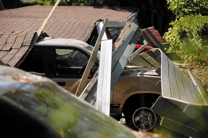 Cars were flattened when the quake damaged a carport at Charter Oaks Apartments in Napa.